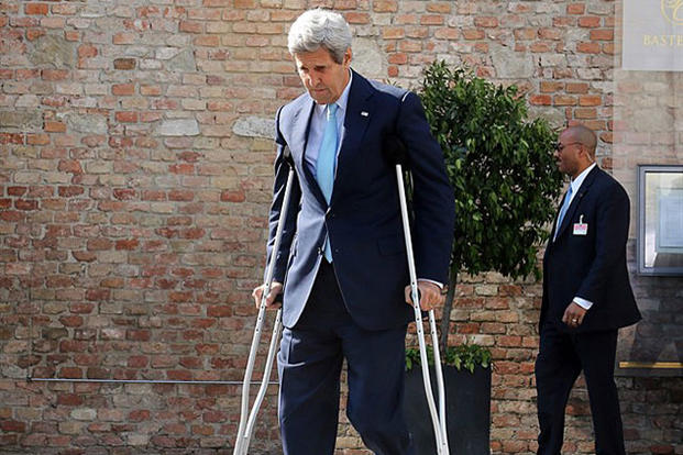Secretary of State John Kerry uses crutches in front of Palais Coburg where closed-door nuclear talks with Iran take place in Vienna on July 5, 2015. He is recovering from surgery to repair a broken right femur from a biking accident. Ronald Zak/AP