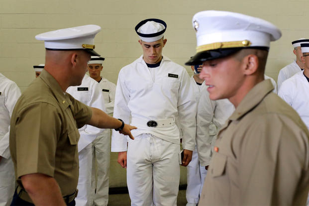 A U.S. Marine Corps second lieutenant orders a prospective plebe to fix his uniform during Induction Day at the U.S. Naval Academy, Wednesday, July 1, 2015, in Annapolis, Md.  (AP Photo/Patrick Semansky)