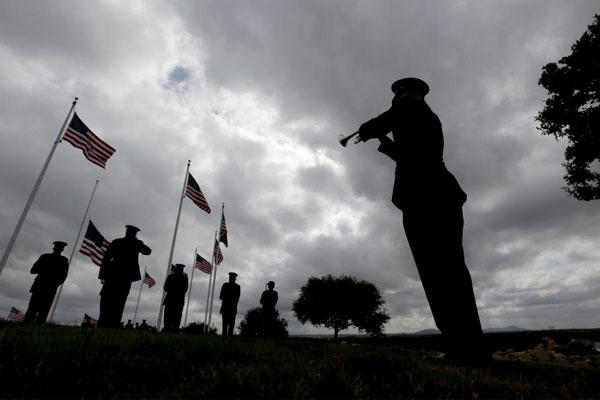 A rifle squad fires a salute for Army Sgt. Charles Schroeter, who was awarded the Medal of Honor for gallantry in an 1869 battle, during a service at Miramar National Cemetery, Thursday, July 9, 2015, in San Diego. (AP Photo/Chris Carlson)