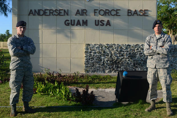 Airmen 1st Class Colby (left) and Travis Wakefield, 36th Security Forces Squadron entry controllers, stand at the entry to Andersen Air Force Base, Guam, July 29, 2015. (U.S. Air Force photo by Airman 1st Class Alexa Ann Henderson/Released)