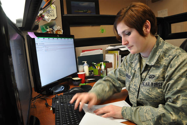 Airman 1st Class Monika L. Chouinard, 9th Comptroller Squadron customer service technician, works on a Permanent Change of Station order at Beale Air Force Base Calif., Jan. 18, 2012. (U.S. Air Force photo by Staff Sgt. Robert M. Trujillo/Released)