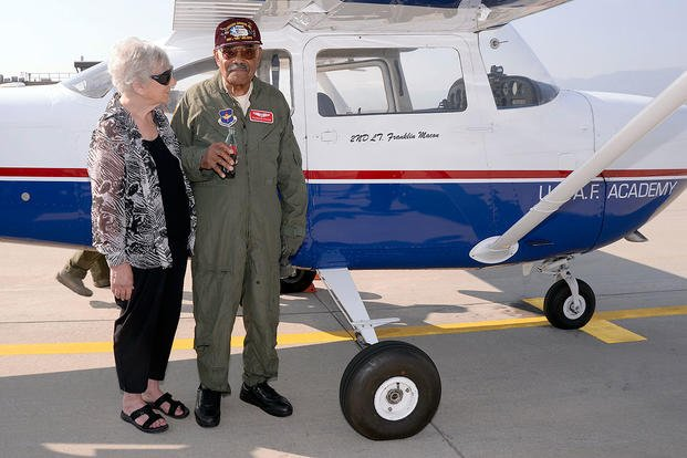 Franklin Macon, a Tuskegee Airman, with his girlfriend Amy Lee, on the U.S. Air Force Academy airfield, Aug. 25, 2015. Macon had just taken a flight with Cadet 1st Class Scott Lafferty in a cadet flying team T-41. (U.S. Air Force photo/Mike Kaplan)