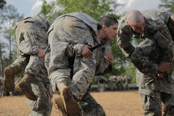 Capt. Kristen Griest, a military police officer from Connecticut, participates in close arm combatives during the Ranger Course on April 20 at Fort Benning, Georgia. She was one of the first two women to complete Ranger School. (US Army photo)