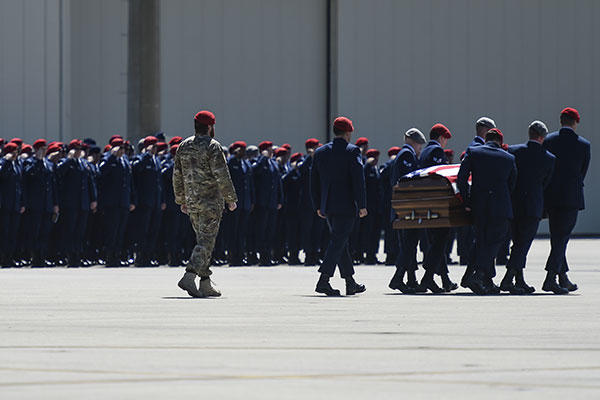 Special Tactics Airmen bear the remains of Staff Sgt. Forrest B. Sibley during a dignified transfer on Hurlburt Field, Fla., Sept. 14, 2015. (U.S. Air Force/Airman Kai White)