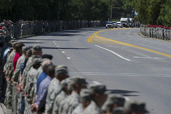 Hurlburt Field personnel line Independence Road to honor Staff Sgt. Forrest Sibley, a combat controller from the 21st Special Tactics Squadron, and his family during a procession. (U.S. Air Force/Senior Airman Hayden K. Hyatt)