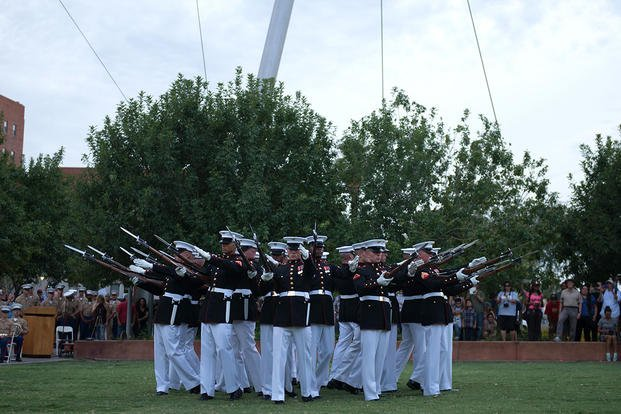 The United States Marine Corps Silent Drill Platoon preforms a series of rifle maneuvers at Civic Space Park, Phoenix, Sept. 9, 2015, as part of the opening ceremony for Marine Week Phoenix. (Photo: Sgt. Cuong Le)