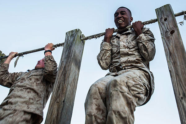 Lance Cpl. Calvin Sawyers conducts a max set of pull-ups after completing a 1.5 mile ruck run as part of a scout sniper screener at Marine Corps Base Camp Lejeune, N.C., Oct. 20, 2015. (U.S. Marine Corps/Cpl. Kirstin Merrimarahajara)