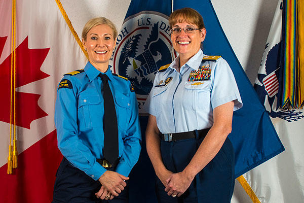 Julie Gascon, the Canadian Coast Guard assistant commissioner for the Central and Arctic Region, stands with Rear Adm. June Ryan, the commander of the Coast Guard 9th District, Oct. 20, 2015. (U.S. Coast Guard/PO3 Christopher M. Yaw)