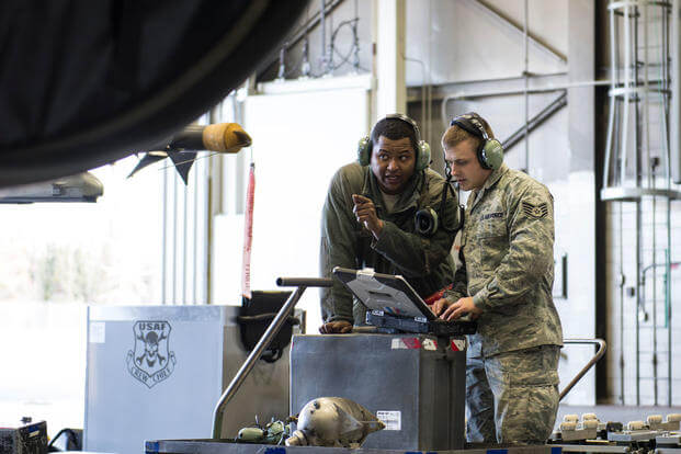 Senior Airman Terrence Lawrence and Staff Sgt. Eric Fitch, 354th Aircraft Maintenance Squadron maintenance specialists, troubleshoot an F-16 Fighting Falcon at Eielson Air Force Base, Alaska, Oct. 7, 2015. (Photo: Staff Sgt. Joshua Turner)
