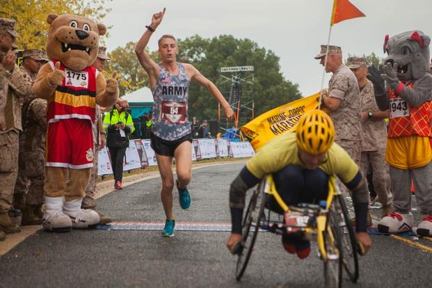 Trevor Lafontaine, the first male finisher, completes 40th Marine Corps Marathon at Arlington, Virginia, Oct. 25. LaFontaine finished the 26.2-mile race in 2:24. (Photo By: Sgt. Justin M. Boling)
