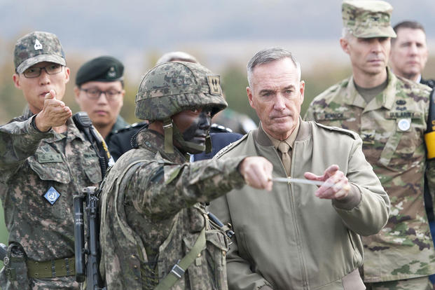 Marine Corps Gen. Joseph F. Dunford Jr. listens to a South Korean soldier brief him during a trip to the Demilitarized Zone in South Korea, Nov. 2, 2015. (Photo by: Navy Petty Officer 2nd Class Dominique A. Pineiro)