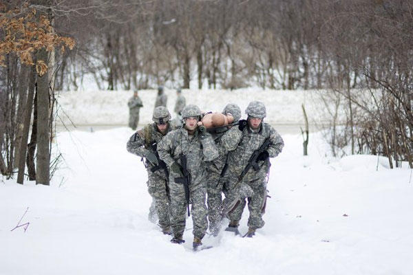 An Intelligence and Sustainment Company team races through the snow transporting a simulated casualty to a landing zone during the Gauntlet Challenge on Fort Drum, N.Y., in this file photo. (U.S. Army photo/Spc. Ferdinand Rejano)