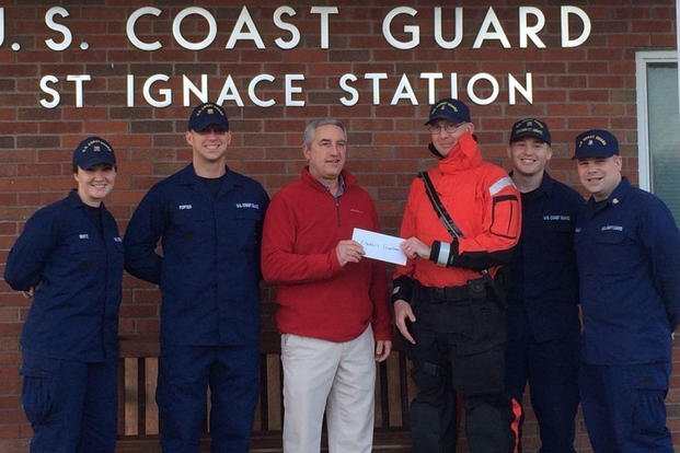 CG Station St. Ignace, Mich., and CG Chief Petty Officers Association partnered with the Kiwanis Club to make a donation Dec. 4, 2015, to provide meals to local families in need during the holiday season. (Photo: Senior Chief Petty Officer Mike Beatty)