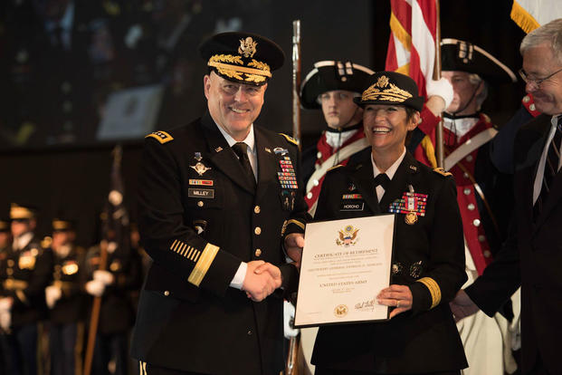 Army Chief of Staff Gen. Mark A. Milley awards a Distinguished Service Medal to Army Surgeon General Lt. Gen. Patricia D. Horoho during a retirement ceremony at Conmy Hall on Joint Base Myer-Henderson Hall, Va., Dec. 15. (Photo: Cpl. Cody W. Torkelson)