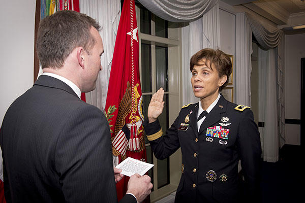 Acting Army Secretary Eric Fanning swears in Lt. Gen. Nadja West as the 44th surgeon general of the Army and commanding general of U.S. Army Medical Command, Dec. 11, 2015. (U.S. Army/John Martinez)