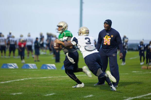 Lt. Col. Robert B. Green runs football players through drills during practice Nov. 17, 2015, at the U.S. Naval Academy in Annapolis, Maryland. (Photo: Sgt. Terence Brady)