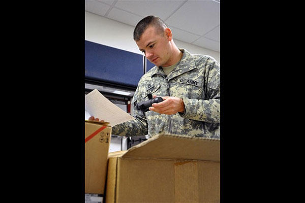 Army Sgt. 1st Class Daniel Aguirre checks incoming equipment against the inventory checklist. (Iowa National Guard/Army Master Sgt. Duff E. McFadden)
