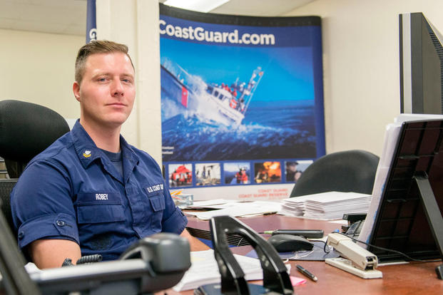 Petty Officer 2nd Class David Robey, Boston MEPS's Coast Guard liaison, sits at his desk Thursday, Dec. 10, 2015. (Photo: Petty Officer 2nd Class Cynthia Oldham)