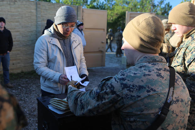 Lance Cpl. Jordan Martin evaluates and records a refugee role player's identification paperwork during a noncombatant evacuation training operation at Marine Corps Base Camp Lejeune, North Carolina, Jan. 14, 2016. (Photo: Lance Cpl. Shannon Kroening)