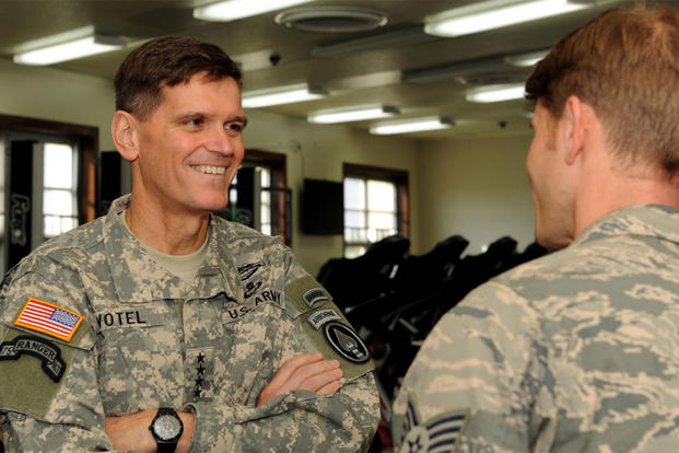 U.S. Army Gen. Joseph Votel speaks with Staff Sgt. Dustin Gorski, a pararescueman, during a visit to the Human Performance Center at Kadena Air Base, Japan Dec. 15, 2014. (U.S. Air Force photo by Airman 1st Class Zade Vadnais)