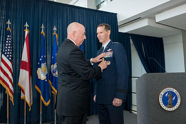 Former Air Force Chief of Staff Gen. T. Michael Moseley pins the Distinguished Service Medal on Lt. Gen. Stanley E. Clarke III during the former's retirement ceremony at Joint Base Andrews, Md. (Air National Guard/Master Sgt. Marvin R. Preston)