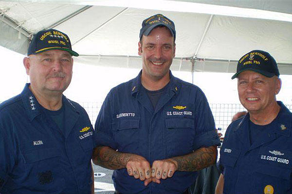 "Coast Guard Chief Petty Officer Richard Sambenedetto poses with Adm. Thad Allen, the 23rd Commandant of the Coast Guard, and the 10th Master Chief Petty Officer of the Coast Guard Charles ""Skip"" Bowen. (U.S. Coast Guard)"