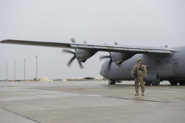 Staff Sgt. Tyler Berogan, a 455th Expeditionary Security Forces Squadron Fly Away Security Team member, provides security as a C-130J Super Hercules is unloaded at Camp Bastion, Afghanistan, Jan. 3, 2016. (U.S. Air Force photo/Tech. Sgt. Robert Cloys)