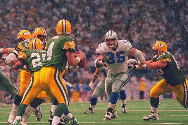 Chad Hennings, center right, played for the Dallas Cowboys for nine seasons. During that time he was part of three Super Bowl winning teams and played in 119 games, recording 27.5 sacks. (Photo courtesy/Dallas Cowboys)