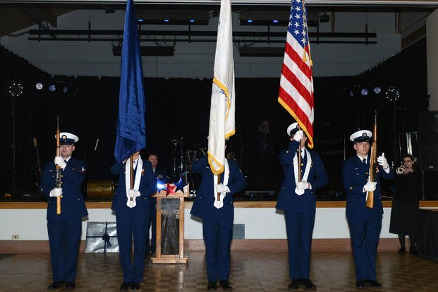 Coast Guard crewmembers from Base Ketchikan, Alaska, present colors at a ceremony hosted by the Greater Ketchikan Chamber of Commerce, Jan. 30, 2016. (Photo: Petty Officer 3rd Class Meredith Manning)