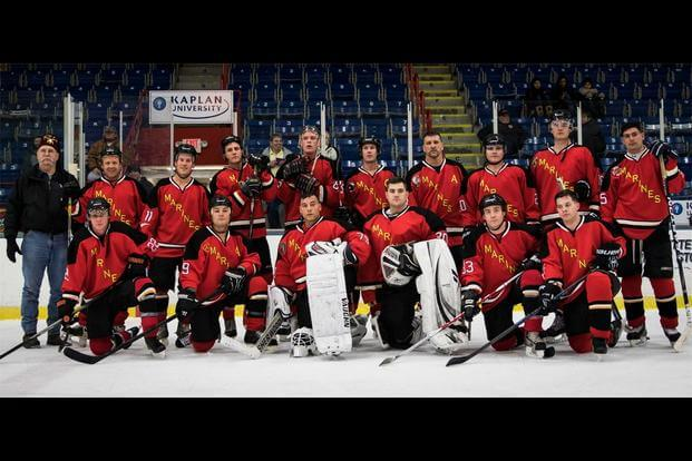 The Marine Corps Ice Hockey Team poses for a photo following first game during The Maine Event, Battle on Ice hockey tournament, Jan. 15. (Photo: Sgt. Jonathan G. Wright)