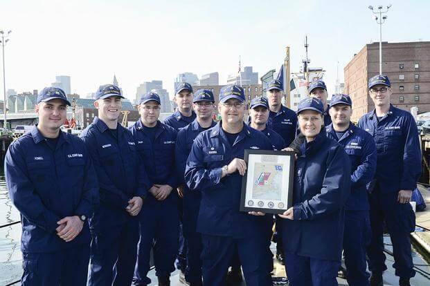 Rear Adm. Linda Fagan, commander of the First Coast Guard District, stands with the crew of the Coast Guard Cutter Flying Fish after she presented the team a Mission Excellence Award at Coast Guard Base Boston. (U.S. Coast Guard/PO2 Cynthia Oldham)