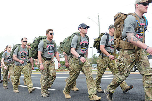 15 Marines and three civilians start a 770-mile ruck from Navarre, Florida, to Marine Corps Base Camp Lejeune, North Carolina to honor 11 service members who died in a helicopter crash one year ago. (Photo: Katie Lange)