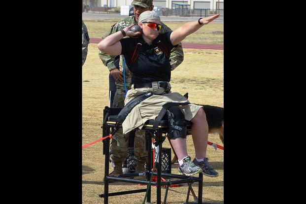 Army Staff Sgt. Tiffany Rodriguez-Rexroad, Warrior Transition Battalion, Brooke Army Medical Center, Fort Sam Houston, Texas, works to improve her shot put skills during a training session Feb. 28, 2016. (U.S. Army photo by Ronald Wolf)