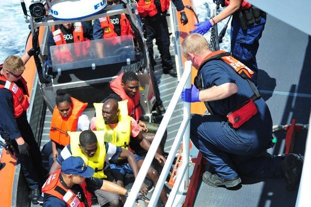 The U.S. Coast Guard Cutter Bernard Webber crew embarks people rescued from a sinking vessel southwest of Freeport, Bahamas on April 9, 2016. (Photo: U.S. Coast Guard)