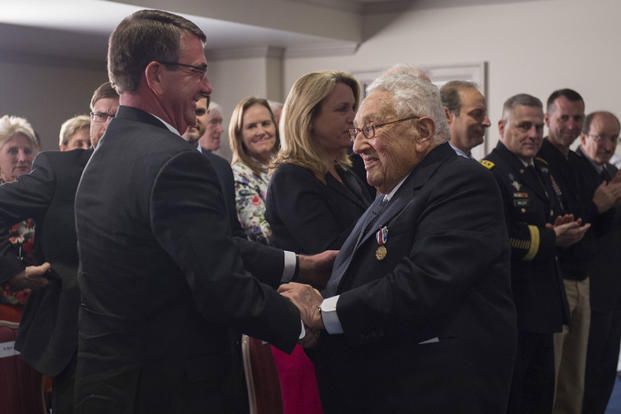 Secretary of Defense Ash Carter shakes Dr. Henry A. Kissinger's hand during an award ceremony at the Pentagon honoring him for his years of distinguished public service May 9, 2016. (DoD photo by Senior Master Sgt. Adrian Cadiz)