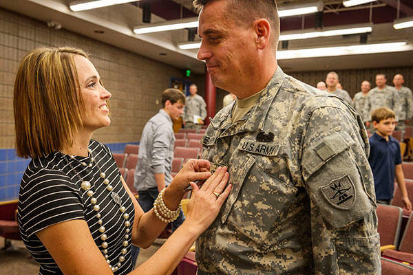 North Dakota National Guard's Jon Erickson has his new rank of colonel affixed to his uniform by his wife Janelle at his promotion ceremony. (U.S. Army National Guard/Staff Sgt. Brett Miller)