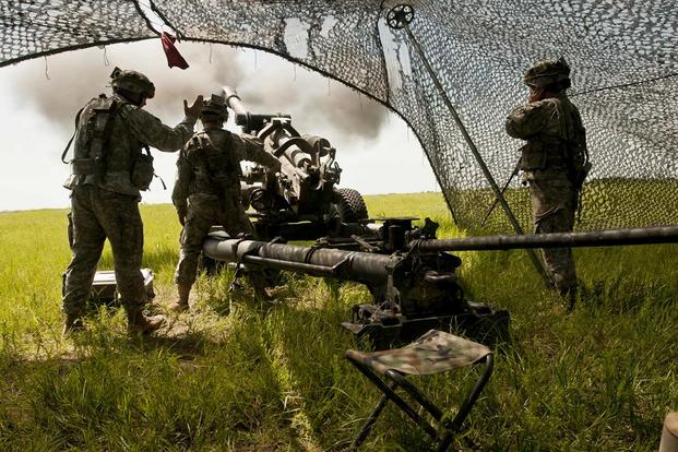 Soldiers of Bravo Battery fire their howitzer during a fire mission coordinated by 1st Lt. Kayla Christopher, the Oklahoma Army National Guard's first qualified female field artillery officer, at Fort Riley, Kansas. (U.S. Army/Sgt. Anthony Jones)