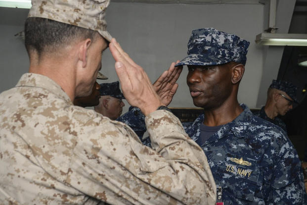 Gen. Francis Donovan, commander, Task Force 51, receives a salute from Capt. Keith Moore as Moore relinquishes command of Amphibious Squadron One during a change of command ceremony. (Photo: Mass Communication Specialist 3rd Class Michael T. Eckelbecker)