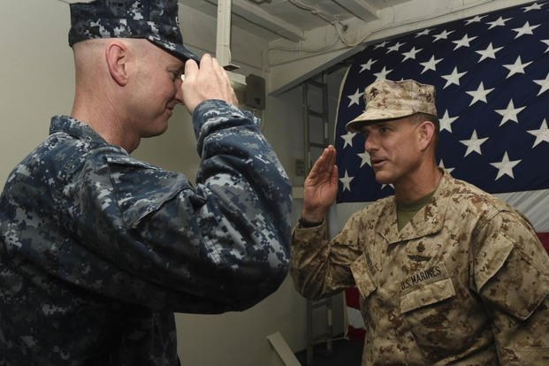 Gen. Francis Donovan, commander, Task Force 51, receives a salute from Capt. Patrick Foegduring a change of command ceremony. (Photo: Mass Communication Specialist 3rd Class Michael T. Eckelbecker)