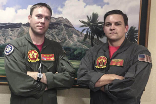 Chief Aviation Aircrewman Jason Lessley and Aviation Aircrewman 2nd Class Hunter Price from Helicopter Sea Combat Squadron (HSC) 15 provided emergency care to a tourist in medical distress on the Diamond Head Trail in Honolulu. (Photo: U.S. Navy)