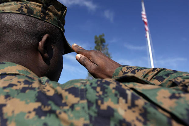 Administrative law noncommissioned officer in charge, Marine Corps Installations West, Camp Pendleton, renders honors to the American flag with a salute, Feb. 10, 2010. (Marine Corps photo by Sgt. Michael T. Knight)