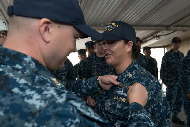 Chief Culinary Specialist Dominique Saavedra, assigned to USS Michigan is pinned with her enlisted submarine qualification during a ceremony at Puget Sound Naval Shipyard (U.S. Navy photo/Kenneth G. Takada)