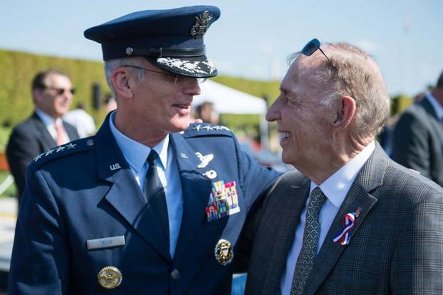U.S. Air Force Gen. Paul Selva speaks with Ret. Navy Capt. Gerald Coffee after a ceremony commemorating National Prisoner of War (POW) / Missing In Action (MIA) Recognition Day outside the Pentagon, Sept. 16, 2016. (DoD photo/Sgt. James K. McCann)