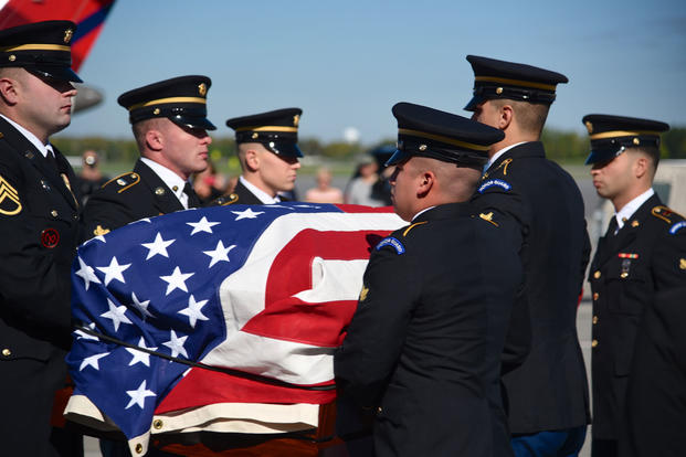 Members of the New York Army National Guard's Military Forces Honor Guard conduct a dignified transfer of remains for a Korean War Soldier's remains, Sgt. 1st Class Louis Baxter, Oct. 5, 2016. (U.S. Air National Guard/Master Sgt. Eric Miller)