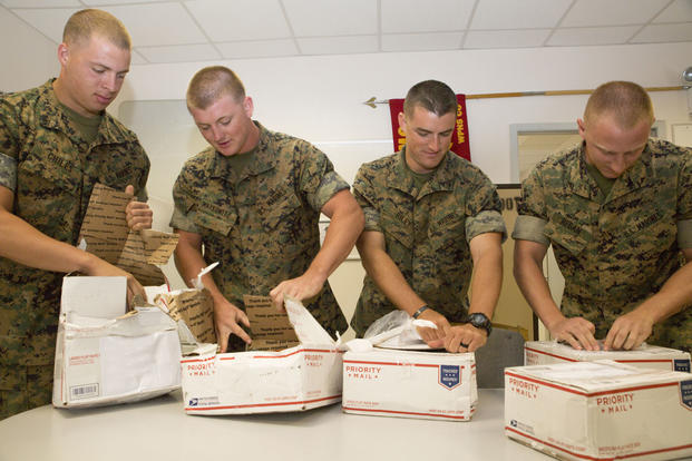 us marines with black sea rotational force 162 open care packages containing a variety of snack