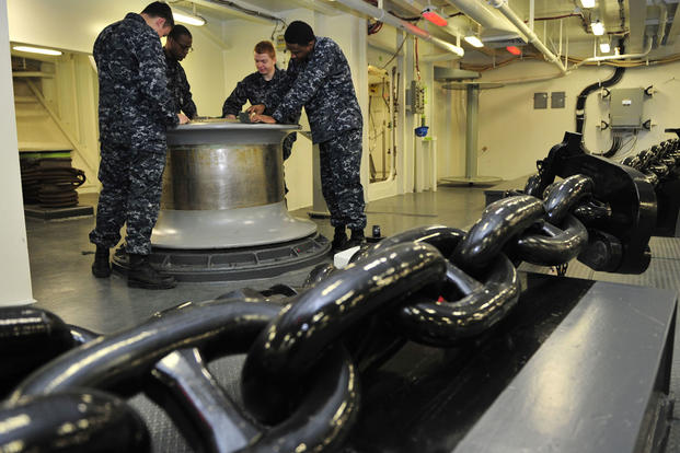 Deck Department Sailors assigned to Pre-Commissioning Unit Gerald R. Ford (CVN 78), polish the capstone inside the ship's forecastle, Feb. 22, 2016. (U.S. Navy/Mass Communication Specialist 3rd Class Kristopher Ruiz)