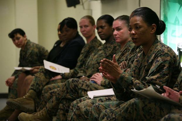 1st Sgt. Roxanne R. Collins, the first sergeant of Camp Lejeune's Engineer Maintenance Company, 2nd Maintenance Battalion, addresses Marines at the air station's Aerial Port of Embarkation. (Marine Corps/Pfc. Samantha H. Arrington)