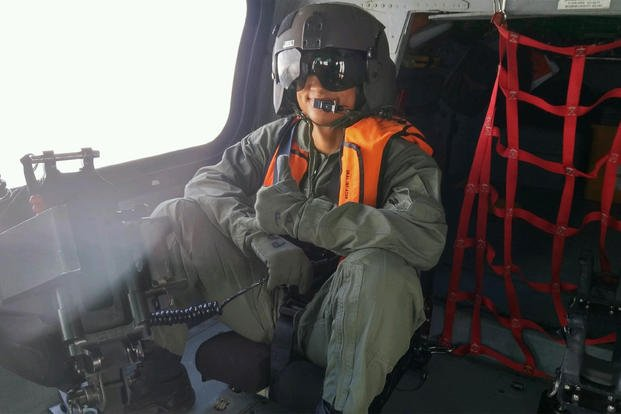 Seaman Gregory Jacquet on a training flight. U.S. Coast Guard photo.