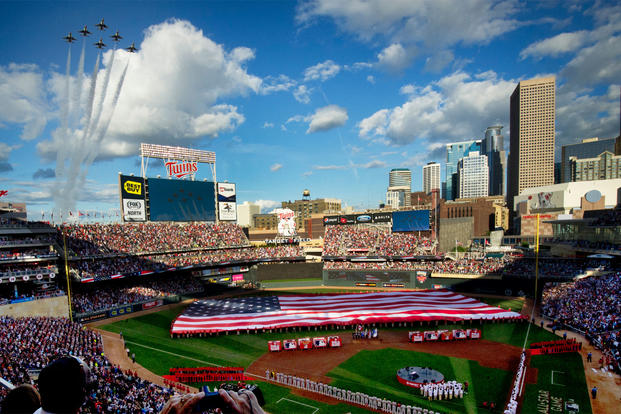 The Thunderbirds perform a flyover during the national anthem at the Major League Baseball's All-Star Game July 15, 2014, in Minneapolis, Minn. (U.S. Air Force photo/Master Sgt. Stan Parker)