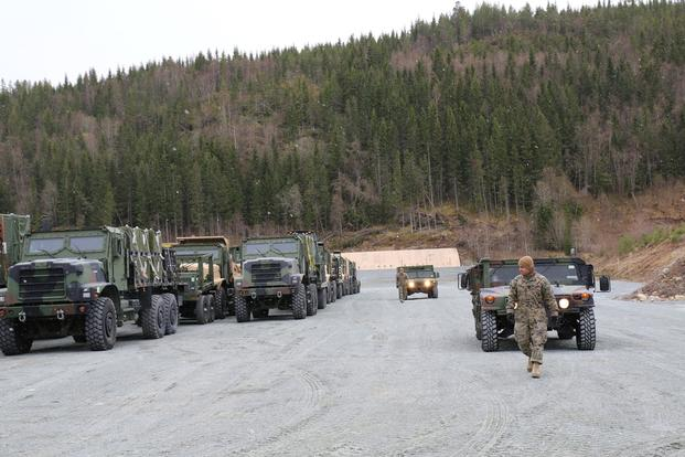 U.S. Marines directed combat vehicles at the Vaernes Garrison in Norway. (Photo by Hope Hodge Seck/Military.com)